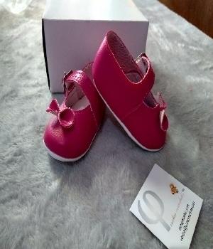 Imagen de Zapatitos para bebe rosa con moño